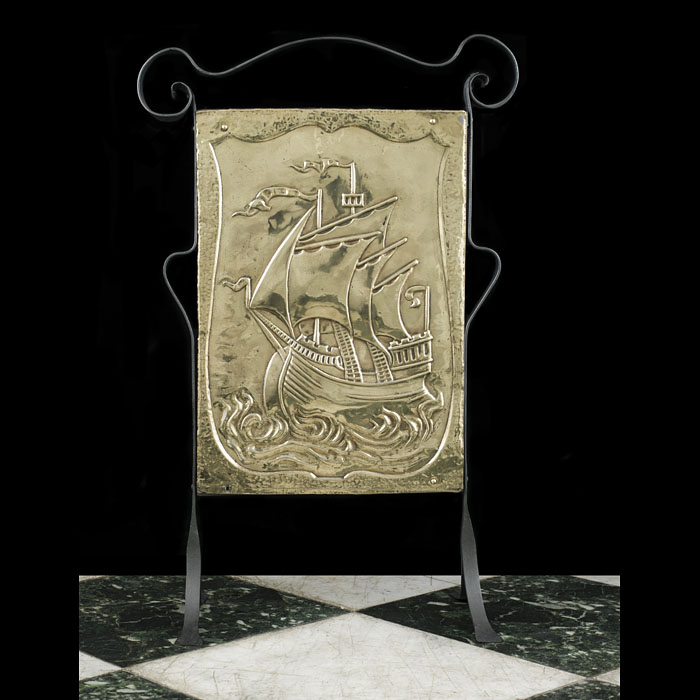 8916: A simple Arts and Crafts brass and iron firescreen decorated with a Galleon. English, circa 1920.  Link to:  Antique Firescreens.