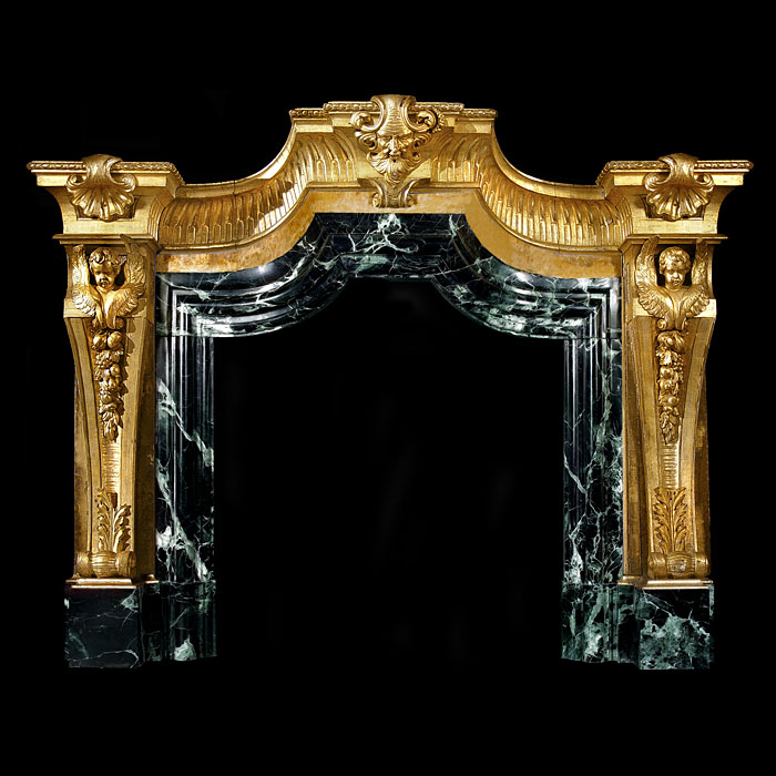 A very large Venetian Baroque carved giltwood antique fireplace