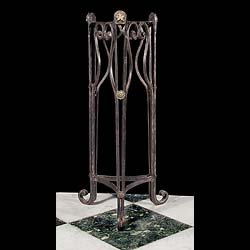Antique Wrought Iron Gueridon in the Neo Classical style  A Wrought Iron Plant Stand with Lion Mask in the manner of Neo Classicism, mounted on rosettes. 19th century.