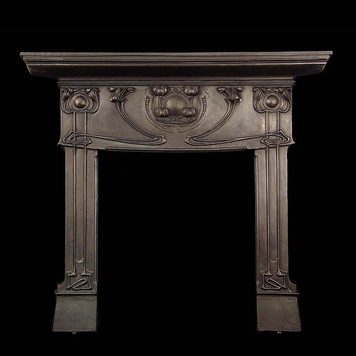 An Art Nouveau cast iron Voysey style fireplace surround