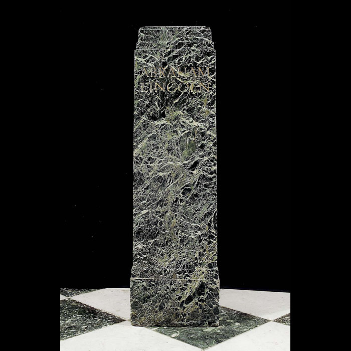 An antique marble plinth engraved with the name Abraham Lincoln