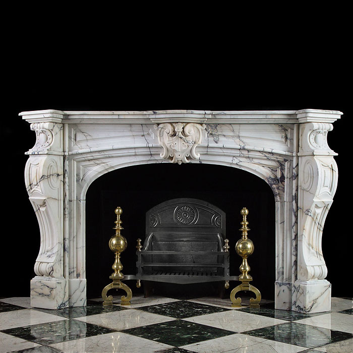 A 19th century antique French Baroque Pavaonazza Marble fireplace