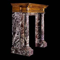 A 19th century Rosso Lavanto marble & walnut Chimneypiece