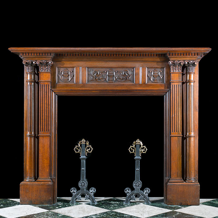 A carved oak Renaissance style Victorian chimneypiece