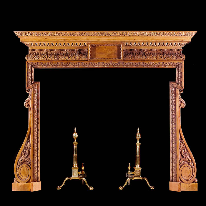A George II carved pine antique fireplace surround