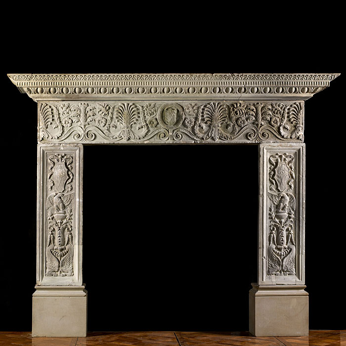 9137: HONI SOIT QUI MAL Y PENSE:  An imposing and richly carved large stone chimneypiece in the Italian Renaissance manner. The well proportioned shelf carved with delicate ' fenestration ' over bold scaled