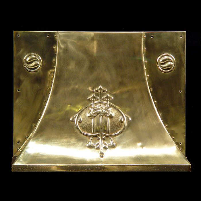 An antique brass fireplace hood
