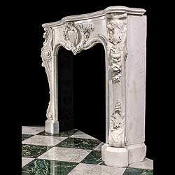 Antique White Statuary Marble Fireplace in 18th Century English Rococo manner.