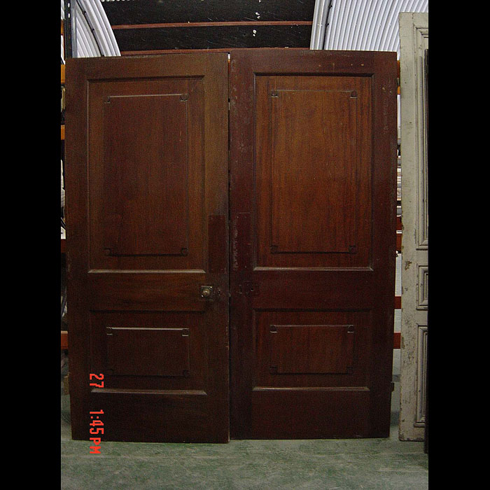 9193: A large pair of two panel Mahogany doors in the English Regency manner. Circa 1930's.  Link to: Antique Doors and Windows.
