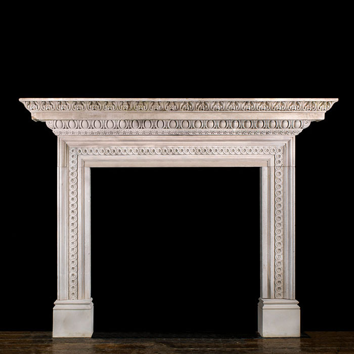 A grand Palladian style stone chimneypiece