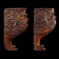 9270: A pair of Mannerist carved walnut figural brackets, depicting the faces of grotesque wood nymphs.Italian,17th century.   Link to: Antique sculptures, carvings, plaques, tablets, coats of arms and pane