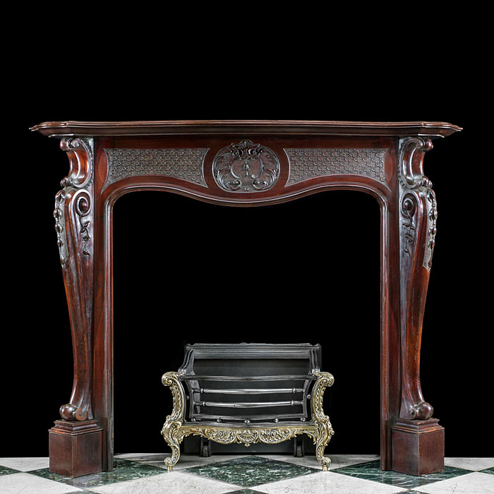 A Mahogany Rococo Style Fireplace Surround