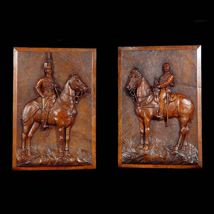 A pair of carved walnut depiction of mounted Hussars