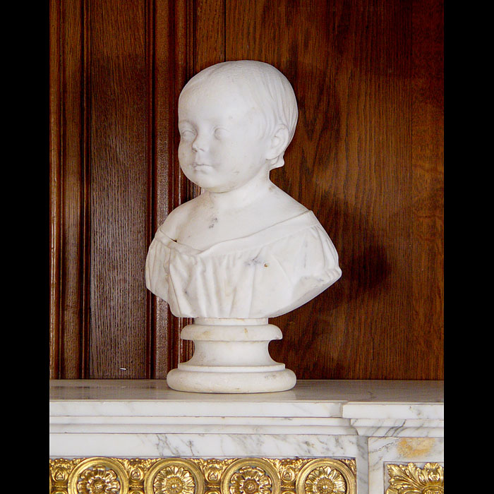 An antique marble bust of a child