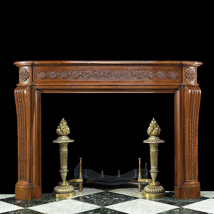 A Carved Walnut Louis XVI Chimneypiece