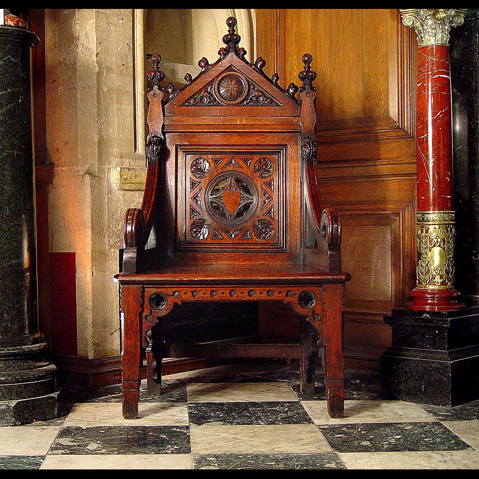 A carved oak antique Bishops Throne