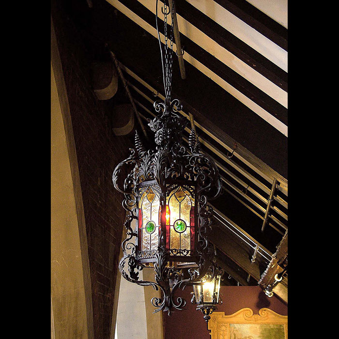 A Victorian wrought iron antique porch lantern in the Venetian manner