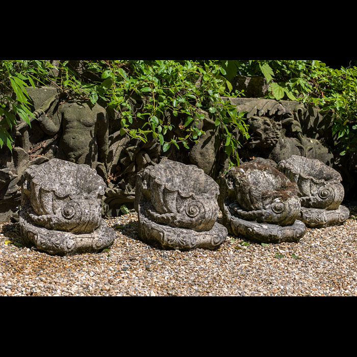 Cornucopia styled antique set of four stone garden bowls