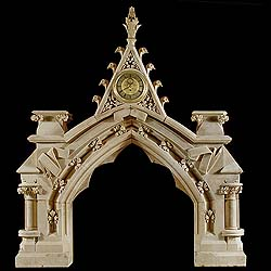 A Gothic Revival antique stone fireplace mantel.
