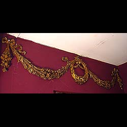 9481:  A large decorative gilt bronze overmantel cresting in the form of two large floral swags centered with an oval Laurel garland, and flanked by ribboned Thistle pendants. English early 20c. Pair t