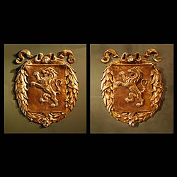 9487:  A pair of gilt bronze rampant lion plaques.   Shown together with a seperate pair of oval mirror frames.