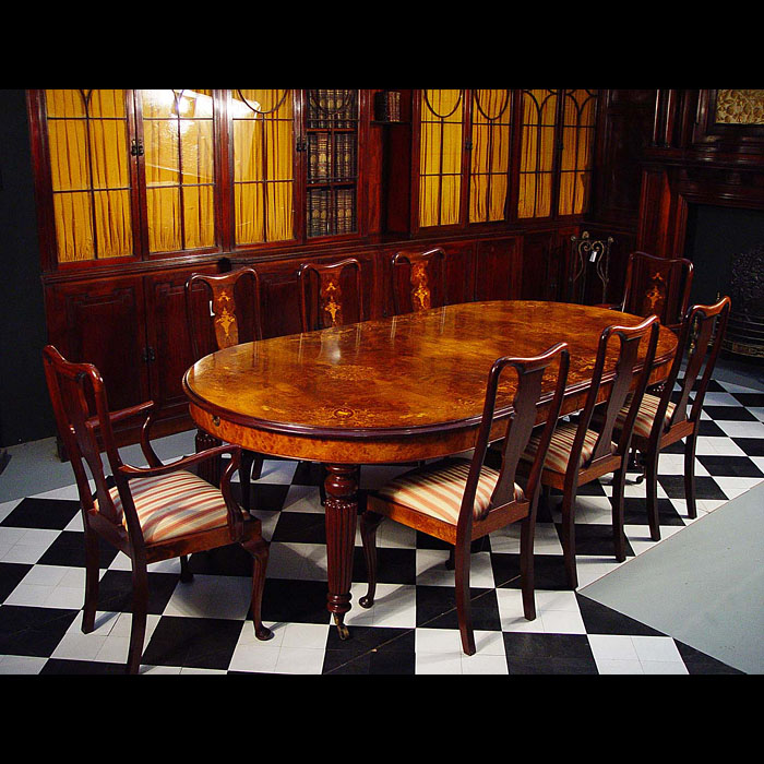 A 20th century Queen Anne style walnut and mahogany dining table