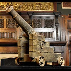 9512: A small cast iron Naval / Battery / Fort cannon mounted on an iron wheeled wooden base. Victorian, 19th century.