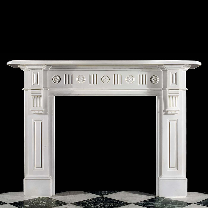 A Victorian statuary marble antique fireplace with Tudor Rose detail