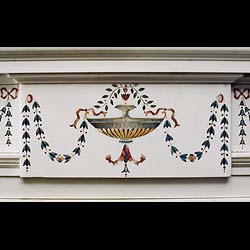 Antique Georgian Irish fireplace with Scagliola Inlay  This stunning, decorated Georgian Chimneypiece with a rare Scagliola inlaid pattern of Bellflower garlands. A central tablet shows an overflowing fountain, with flanking Etruscanesque urns depicted on the endblocks. Late 19th century Irish Fireplace Mantle.