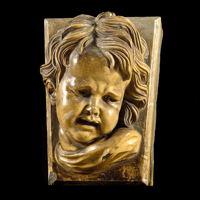 A Victorian ceramic large keystone of a child