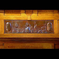 An antique Arts & Crafts oak inlaid fireplace surround