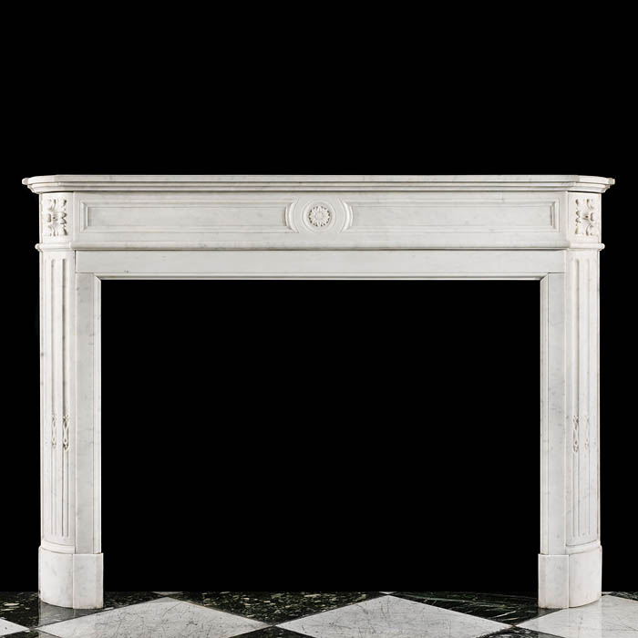 A small French Regency Carrara Marble Fireplace Mantel