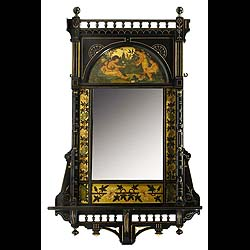 A ebonised Edwardian mahogany Aesthetic Movement mirror