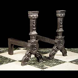 A pair of Jacobean style cast iron Antique andirons