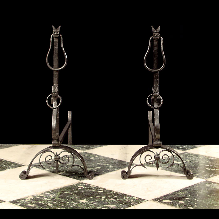 A heavy pair of wrought iron Renaissance style wolfhound Andirons