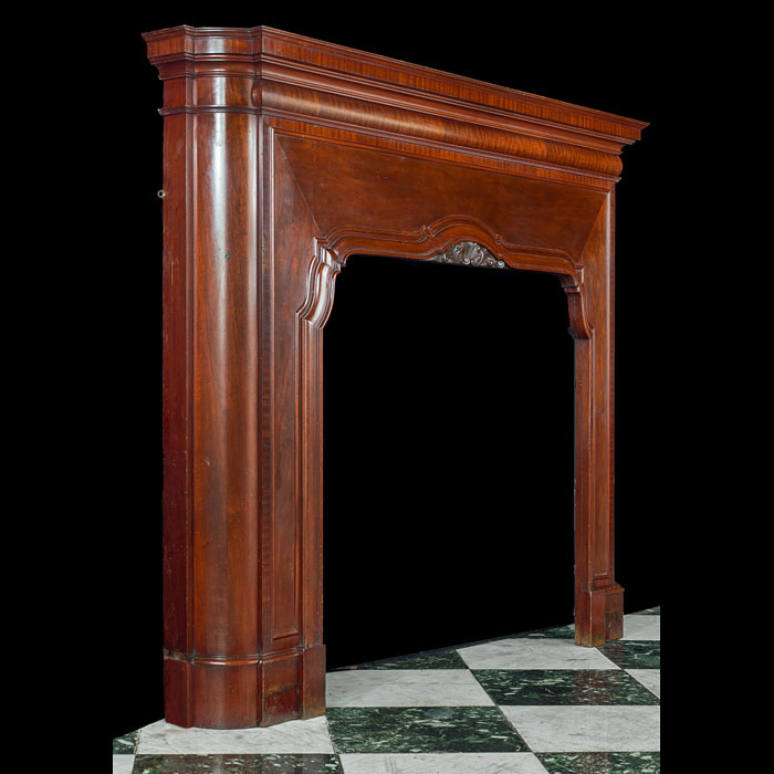 An Art Deco mahogany fireplace surround in the Baroque manner