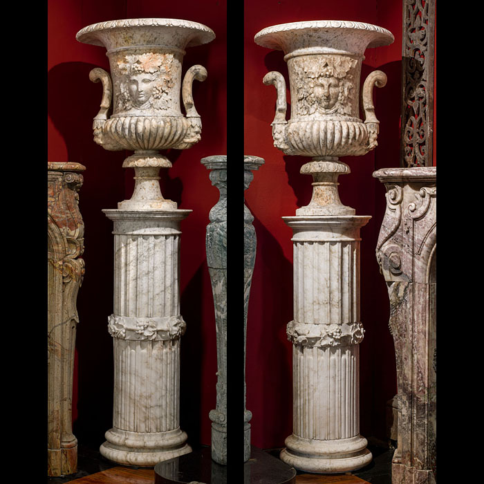 A pair of fine antique alabaster urns mounted on their original pedestals