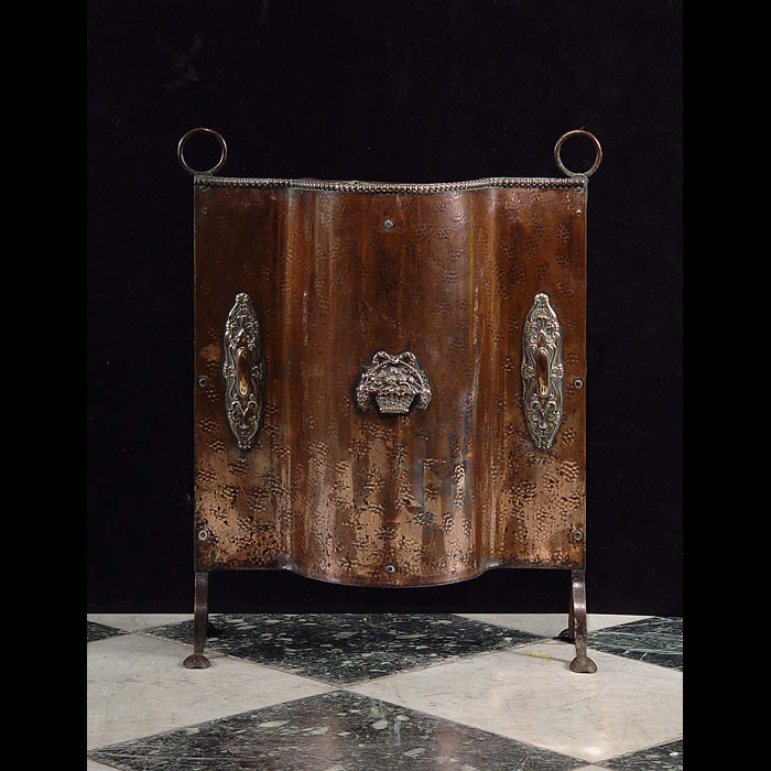 A Copper Fire Guard with floral decoration, 1930
