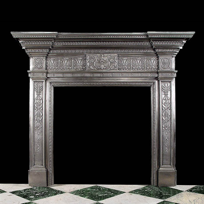 A Georgian style burnished cast iron Antique fireplace mantel