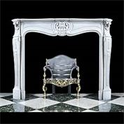 10444: A small and compact Louis XV manner French Rococo fireplace in lightly veined Carrara marble with a fielded frieze centred by a stylised shell cartouche beneath a serpentine breakfront shelf the end b