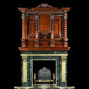 10541: AN IMPRESSIVELY TALL MARBLE CHIMNEYPIECE WITH A GRAND MAHOGANY PANELLED OVERMANTEL IN THE BAROQUE MANNER.The chimneypiece is in Verde Antico dark green and black figured marble with pale yellow, veine