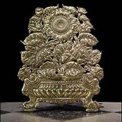 10562: A Dutch embossed brass firescreen in the Baroque manner, with sunflowers and leaves in a gadrooned urn , bordered by Panther cubs. 19th century.  Link to:  Antique Firescreens.