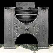 10814: A small cast iron Hob Grate having raised lion head, floral and scroll decoration. Image before restoration and adjustment.  Link to: Antique Hobgrates