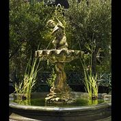 10825: A 19th century composition stone fountain in the 17th century Italian Baroque manner, together with a Coalbrookedale cast iron figure of a putto with a swan..also 19th century. The large clamshell bow