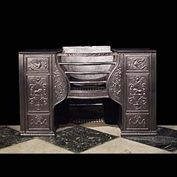 11082: A large cast iron Hob Grate in the style of Robert Adam, fully restored with typical Neo Classical design motifs of the period showing fire breathing winged Chimera and standing Lions. Late 18th centu