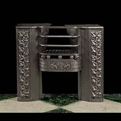 11123: A small cast iron hob grate with scrolled floral decoration.  Link to: Antique Hobgrates