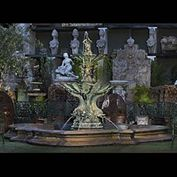 11356: A large patinated bronze two tier fountain in the Baroque manner of Bernini.The top fish tailed young Triton,  a mythological Greek god, the son of Poseidon and Amphitrite, god and goddess of the sea,