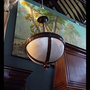 11392: One of two bronze patinated Art Deco style bowl chandeliers in the English Regency Revival taste, with matching original stylised chain.Late 20th century. This the smaller version of SNo 11391.