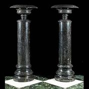 11681: A pair of black marble urns on stands in the classical manner, with shallow bowls above knopped stems and stepped feet, on conforming cylindrical columns. 20th century.   Link to:  Antique Columns, Pl