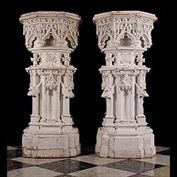 11683: A pair of elaborately decorated Victorian Neo Gothic pedestals in terracotta with pine painted tops, with buttresses, mythical winged gargoyles, quatrefeuille finials and arcading. Image before restor
